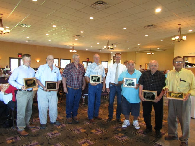 Receiving awards for their support of and participation in the local industry at the 58th Henry County Beef Association Banquet were, from left: Devon Olson, of Geneseo; Bennett Kuster, of Kewanee; Ron Grymonprez, of Cambridge; Brad Bates,of Kewanee; 2021 HCBA president Chad Horsley who presented the awards; Mike Nordstrom, of Annawan; Wilbur Nelson, of Cambridge; and Dean Olson, of Geneseo.