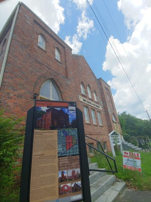 This is Rue Chapel AME Church, 709 Oak St., where the Saving Grace Heritage sign points out historic black churches.