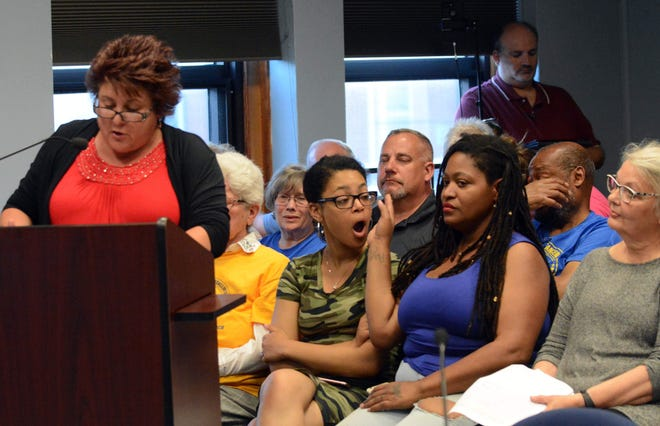 Elionna Vazquez of Killinlgy and her mother Lamonica Vazquez react to comments by Karen Fremuth of Dayville, left, during a Killingly Board of Education overflow meeting on the Killingly High School Redmen mascot controversy July 26, 2019 at Killingly Town Hall.