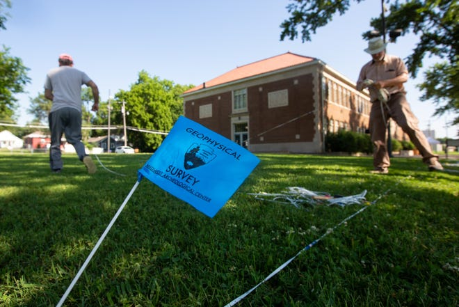 Blue flags show a geophysical survey is being conducted on the grounds of the Brown v. Board National Historic Site, 1515 S.E. Monroe St., by members of the Midwest Archaeological Center and the Kansas Historical Society.