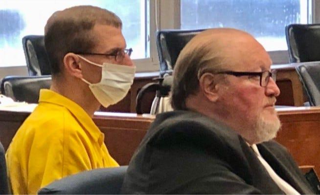 "Jeffrey J. ""James"" Exon, left, and his attorney, Jonathan Phelps, listen to testimony at Exon's preliminary hearing Thursday."