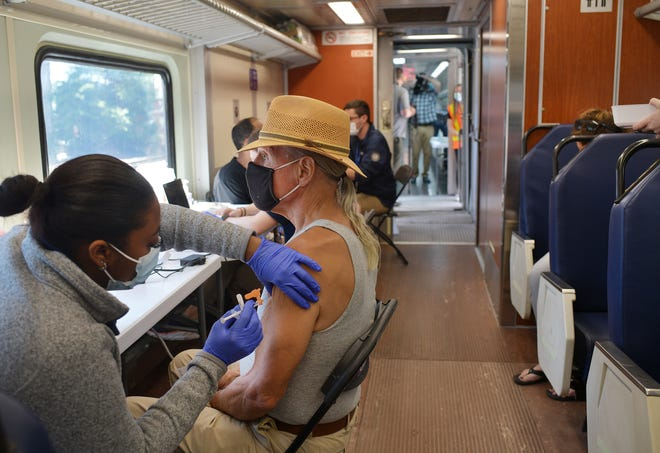 WORCESTER - Charles Buckroth of Holden gets vaccinated by Karessa Victor on the train.  The MBTA had a train car at Union Station that doubled as a vaccination clinic on Thursday, June 17, 2021.