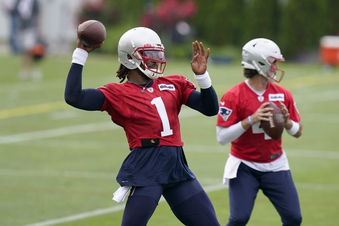 Patriots quarterbacks Cam Newton (1) and Jarrett Stidham work out during OTAs this week in Foxboro.