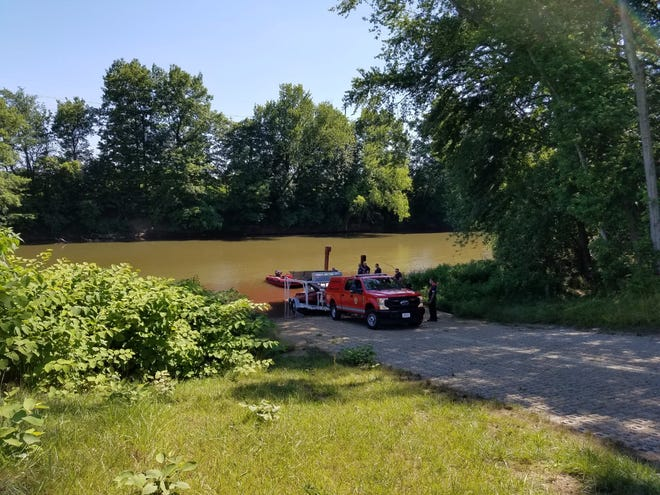 Firefighters from Dover and New Philadelphia respond to a chemical leak at the Tuscarawas River on Thursday afternoon. New Philadelphia Fire Capt. Robert Snyder said the material, sodium permanganate, did not harm water or wildlife. About three gallons was accidentally released from a storage area at the city water department. It turned the water red.