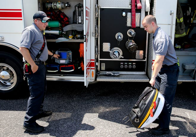 Tuscaloosa Fire Rescue paramedic Wes Michaels and firefighter/EMT Kevin Konstalib show the advanced life support equipment carried on Engine 4 Wednesday, June 16, 2021. [Staff Photo/Gary Cosby Jr.]