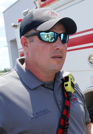 Tuscaloosa Fire Rescue paramedic Wes Michaels shows the advanced life support equipment carried on Engine 4 Wednesday, June 16, 2021. [Staff Photo/Gary Cosby Jr.]