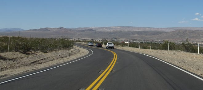 Motorists drive toward Barstow on State Route 247 in 2013.