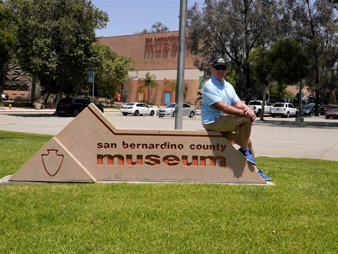 John sits on a San Bernardino County Museum sign outside the museum in Redlands, Calif.