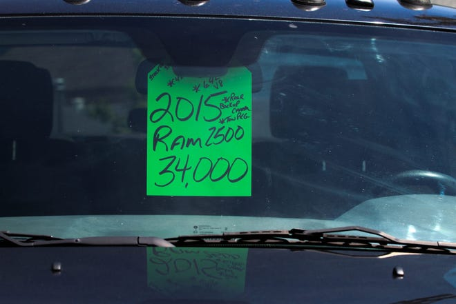 Prices for some used cars are rivaling those of new cars, such as this 2015 Ram truck for sale for $34,000 in Sioux Falls.