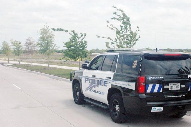 In this 2018 photo, a Waxahachie Police Department patrol vehicle looks over the new North Grove subdivision.