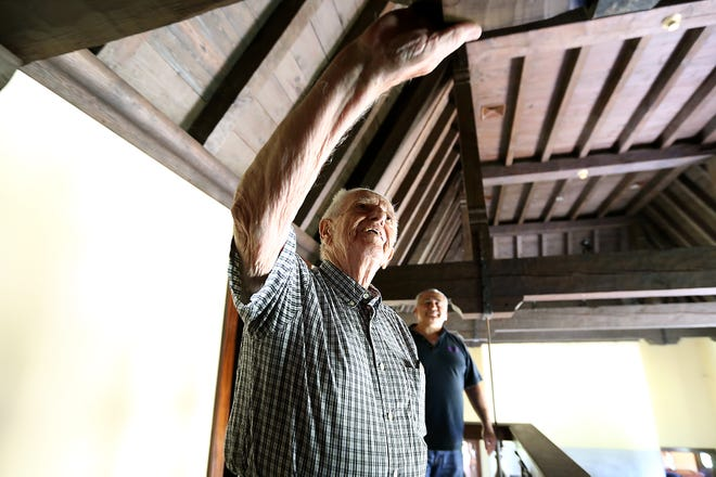 During a tour of the castle on South Main Street in Cohasset, Chuck Vinton of Uxbridge admires the carpentry of his father and grandfather, who worked on the house from 1928 to 1930.