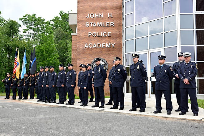 Some of the 200 Club of Union County Valor Award recipients standing outside the John H. Stamler Police Academy in Scotch Plains.