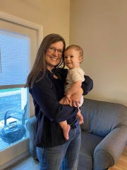 Jen Moseley holds her grandson, Sam. Moseley was diagnosed with invasive lobular carcinoma, a form of breast cancer, shortly after receiving her second COVID-19 vaccine.