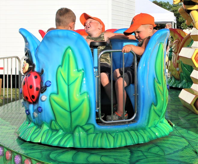 Youngsters have a fun time swirling on the beetle ride at the 2021 Gibsonburg Homecoming Festival.