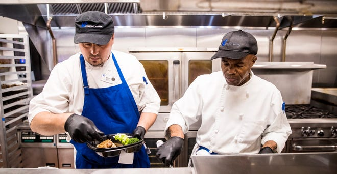 Elton Apostoli and Francois Joseph, both line cooks at Bentley Village in Naples prepare meals that will be delivered to residents on Wednesday, June 16, 2021