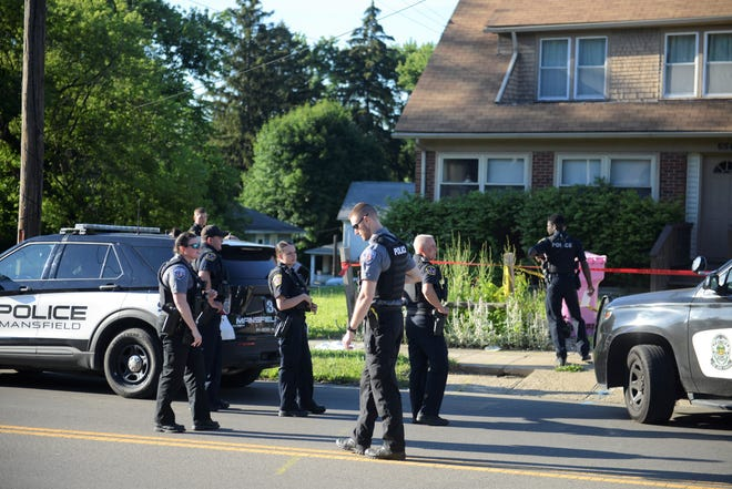 Multiple departments responded to West Fourth Street Wednesday evening for an officer-involved shooting.
