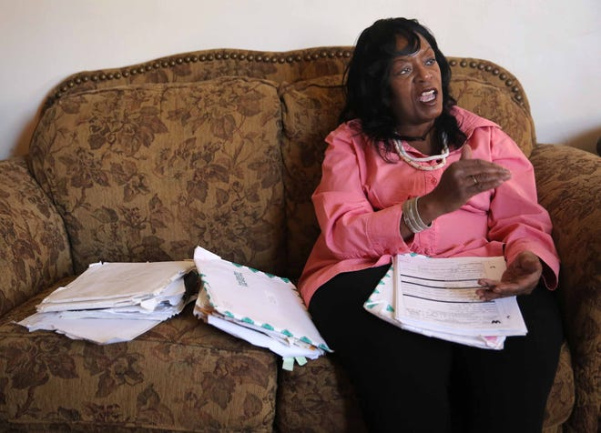 Phyllis Hardy sits in her living room surrounded by paperwork associated with her legal case. Hardy, now 57, believes fen-phen, which she took for several months, caused her to develop a leaky heart valve. Hardy sued and received $326,000 in settlement.