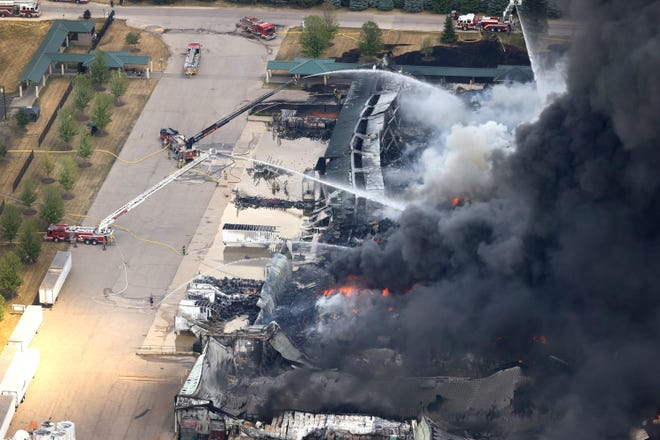 Firefighters from Northern Illinois and Southern Wisconsin battle an industrial fire at Chemtool Inc. on June 14, 2021, in Rockton, Illinois. The chemical fire at the plant which produces lubricants, grease products and other fluids has prompted local evacuations.