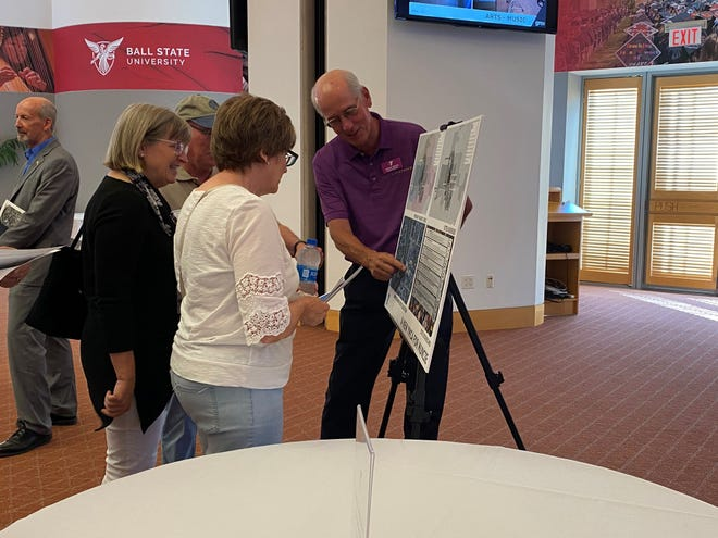 Community members speak with YMCA of Muncie representatives about plans for the organization's new facility, which will be located at Central High School