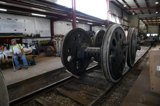 The wheels of a 1942 WW2 locomotive were taken off at The Nashville Steam Preservation in Nashville, Tenn., Thursday, June 17, 2021, to be sent to Chattanooga Tennessee Valley railroad museum to be restored.