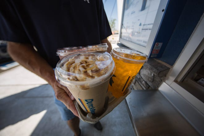 Customers buy drinks at the grand opening of Dutch Bros in Las Cruces on Thursday, June 17, 2021.