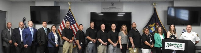 Farmington Hills Police Chief Jeff King, far right, stands with members of the Farmington Hills Police Department Quick Response Team and members of COMEBACK and Families Against Narcotics.
