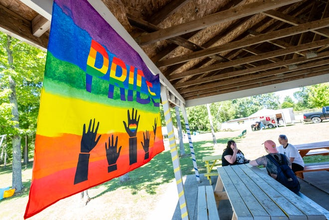 A Pride flag hangs under a pavilion at Kimball Township Park's Sutherland Park during a Pride Month event June 16.