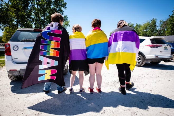 From left, Max Nichol, Jourdin Posey, Quinn Fox and Mae Peters show off their Pride flags during a Pride Month event Wednesday, June 16, 2021, at Kimball Township Park's Sutherland Park.