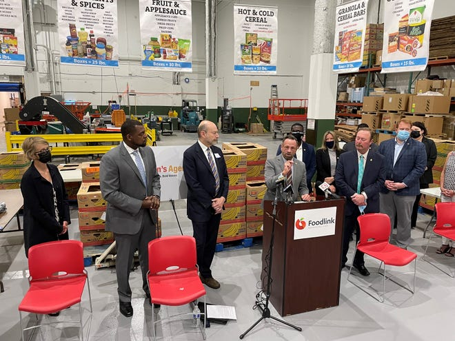 Harry Bronson, at podium, speaks at Foodlink June 17, 2021 regarding the New York Child Poverty Reduction Act.
