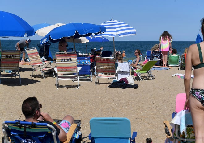 Thousands play and relax on the beach Thursday, June 17, 2021, in Bethany Beach, Delaware.