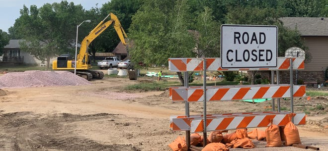 Road construction crews work near the intersection of Yellowstone Drive and Cedar Street in Brandon on Wednesday, June 16, 2021.