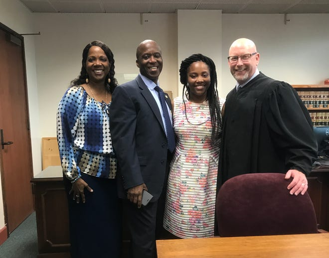 Rosalind, Kwame, Janar, and Judge Ron Flury at adoption on July 5, 2017.