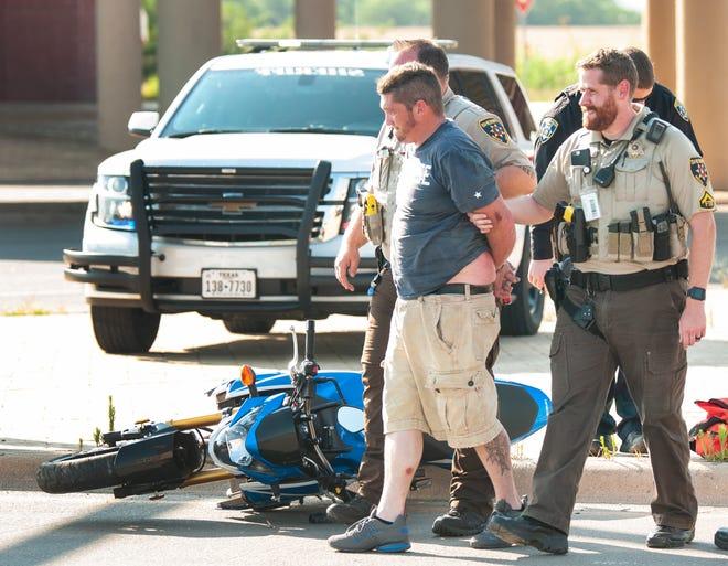 Wichita County deputies take a motorcyclist into custody Wednesday after a pursuit.