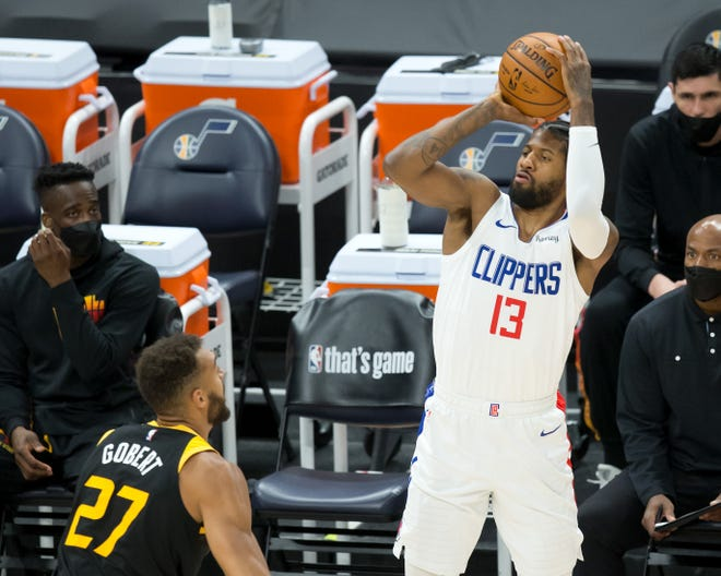 LA Clippers guard Paul George shoots the ball during the first quarter of Game 5 against the Utah Jazz.