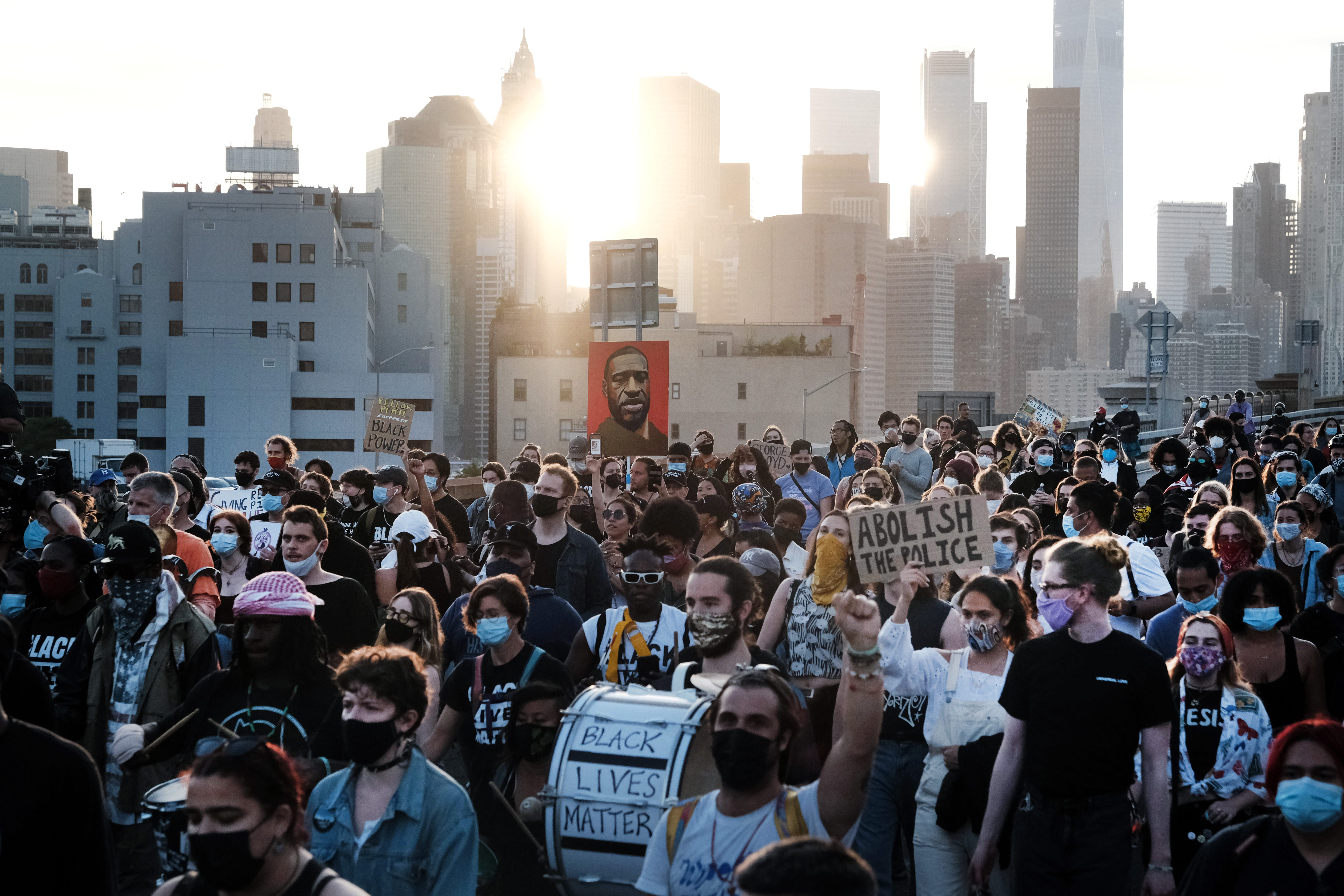 Black Lives Matter supporters and others march across the Brooklyn Bridge on May 25, 2021, in New York City to honor George Floyd on the first anniversary of his death.