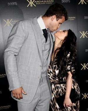 Kim Kardashian West goes in for a smooch with former basketball player Kris Humphries in Los Angeles on Aug. 17, 2011, just days before they tied the knot on Aug. 20.