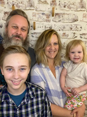 (clockwise from left) Matt Logelin with wife Lizzie Molyneux-Logelin and their daughter Bertie, and Maddy.