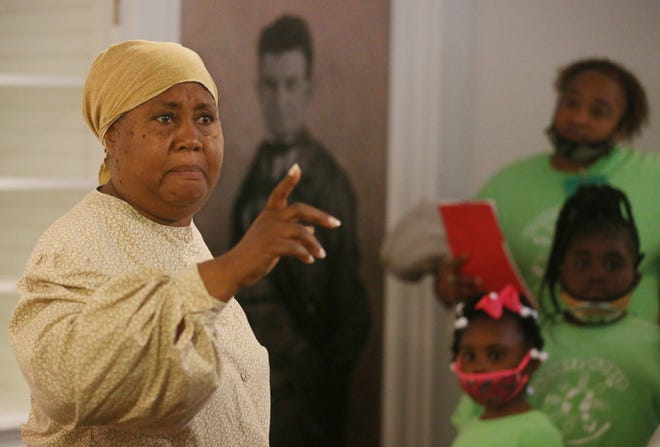 Educator Reva Golden, as Harriet Tubman, talks about John Brown in the home that Brown lived in during his short time in Akron during a Juneteenth - Farm Friday program.