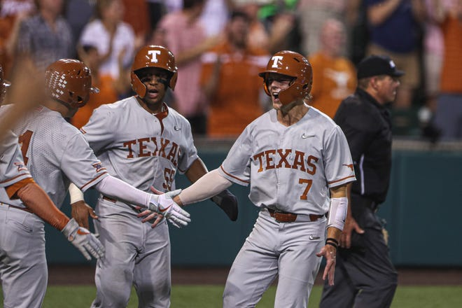 Texas' Douglas Hodo III celebrates a run with teammates during the Longhorns' 12-4 win over South Florida in last weekend's Austin Super Regional, which send UT to the College World Series. Hodo's father won a national championship while playing for the Longhorns in 1983.