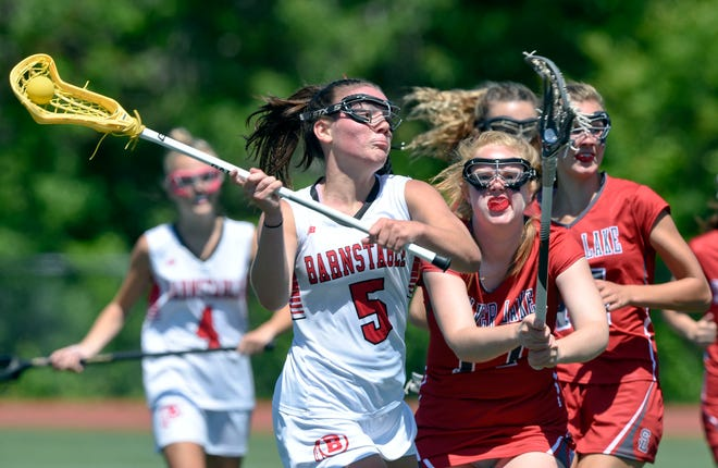 Finley Crosby of Barnstable puts a shot on goal defended by Katie Murphy of Silver Lake.