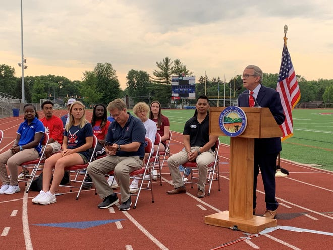 Gov. Mike DeWine encourages high school and middle school student athletes to get vaccinated against COVID-19. He held a press conference June 18, 2021 at Thomas Worthington High School's track.