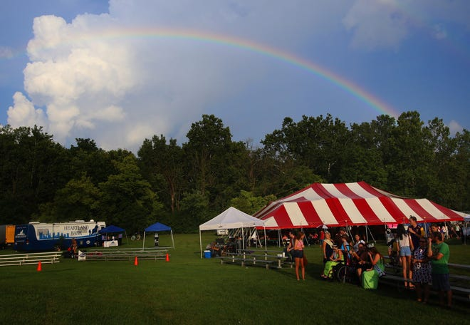 A rainbow spreads over a portion of the Reynoldsburg Tomato Festival during a previous year's event.
