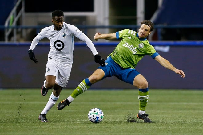Minnesota United midfielder Kevin Molino (7) battles for the ball with Seattle Sounders FC defender Gustav Svensson (4) during the second half at Lumen Field on Dec. 7, 2020. Kevin Molino signed a multi-year deal with the Crew this past offseason. Mandatory Credit: Jennifer Buchanan-USA TODAY Sports