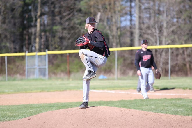 Addison senior Kenny Jarchow winds up for a pitch during a game in the 2021 season.
