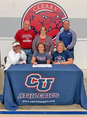 Coldwater's Mia Rzepka signs her letter of intent to play softball at Cleary University. Pictured with Rzepka are (starting back left, clockwise) grandpa Chuck Wheeler, grandma Karen Wheeler, Cleary University head coach Tim Bailey, mother Sara Rzepka, Mia, and Firestix head coach Scott Ouellette.