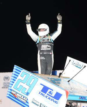 Wyatt Wilkerson, Morning Sun, celebrates his feature win from atop his 305 sprint car Thursday at 34 Raceway.