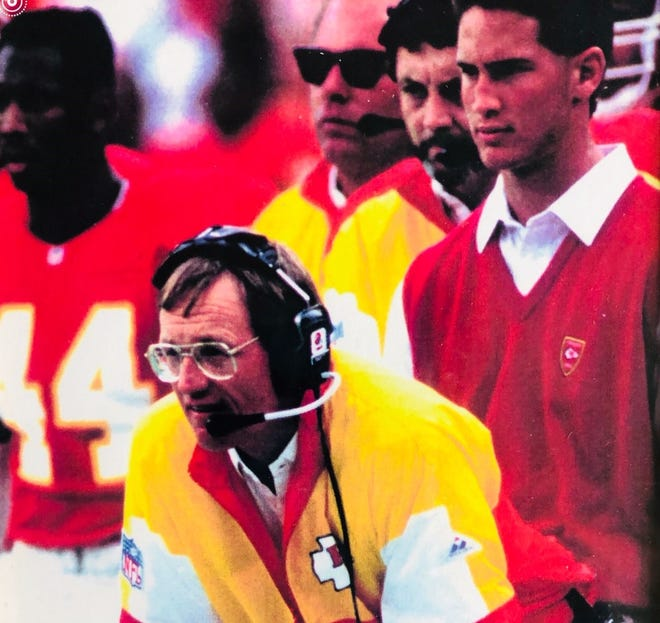 Brian Schottenheimer (right) watches from the sidelines as father Marty Schottenheimer (center) coaches the Kansas City Chiefs during a 1989 NFL game. [Kansas City Chiefs/Provided by Brian Schottenheimer]