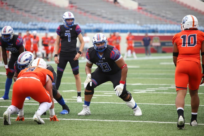Hutchinson CC offensive lineman Kingsley Ugwu (73) gets into his pre-snap stance during the NJCAA national championship game against the Snow College Badgers at War Memorial Stadium in Little Rock, Ark. on June 5, 2021.