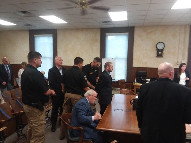 Gary Berchtold, right, was found guilty of first-degree murder and other charges Friday in Marshall County. He's shown here with defense lawyer Roger Bolin, sitting.