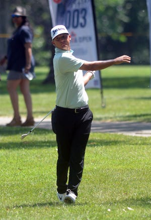 Max McGreevy of Edmond, Okla., after a shot from outside the gallery ropes on the 18th hole of the Crestview Country Club in the first round of the Wichita Open. McGreevy saved par on the hole to finish with an even-par 70 in the first round. The tournament runs through Sunday. McGreevy won the 2013 edition of The Railer: Kansas Amatuer Stroke Play Championship.